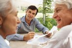 Photo of older couple receiving financial advice